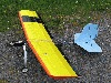 Slow Stick fuselage with a balsa/ply reinforced MagpieAP wing modified with ailerons, and tail feathers cut out of fan-fold foam.